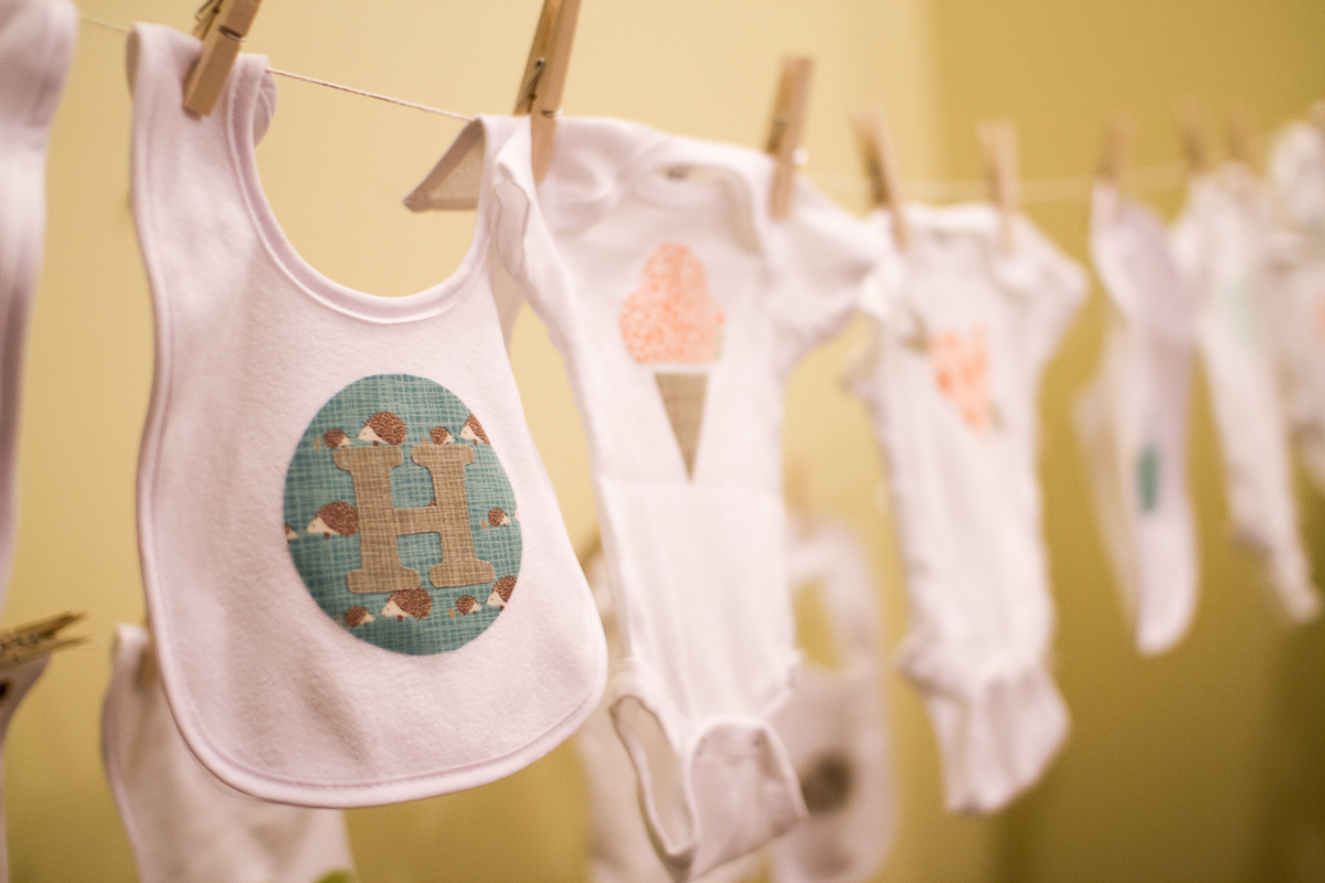 Onesies on Display for a steampunk baby shower